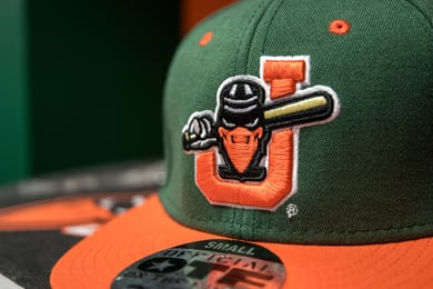 A Joliet Slammers baseball cap featuring the team mascot, a crow